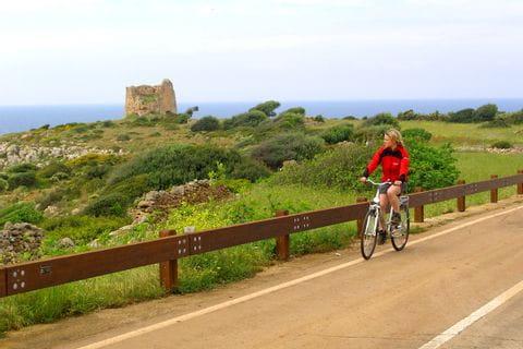 Cyclist on street near the coast