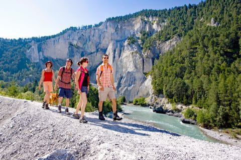 Excited hikers at the Swiss Alpine Passes Trail