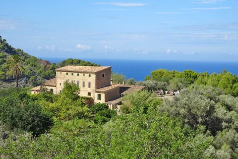 Hiking experience in Deia with coastal view
