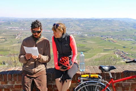 Two cyclists having a break in the Barolo region