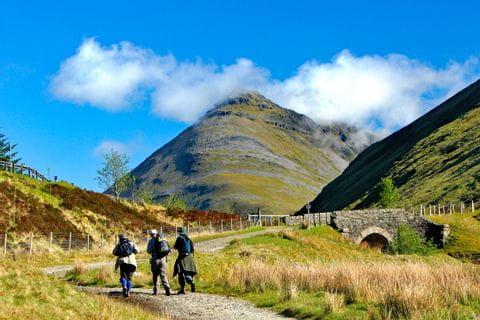 Hiker on their way through Scotland